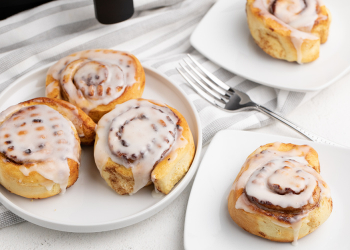 Pillsbury Cinnamon rolls made in the Air Fryer on a white plate.