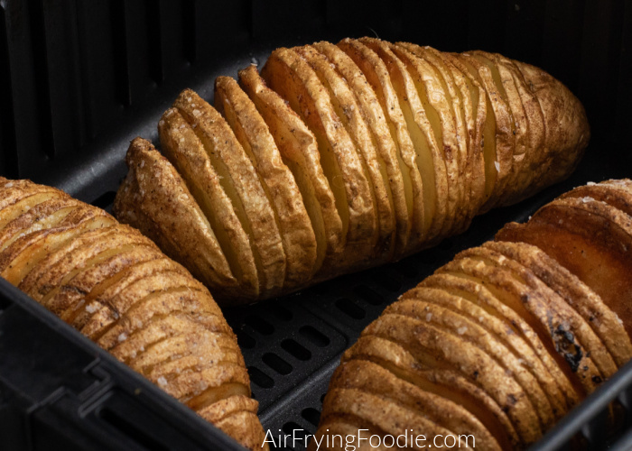 Hasselback potatoes fully cooked and in the Air Fryer basket.