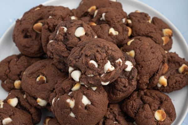 Air Fryer chocolate cookies with white chips, served on a white plate.