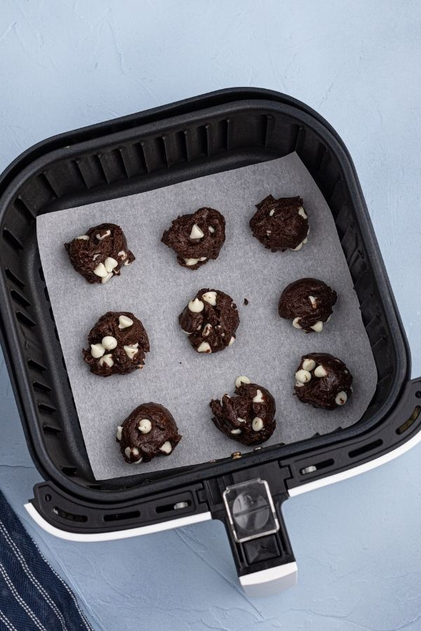 Cake mix cookie dough, scooped into small balls, placed on parchment paper in the air fryer basket