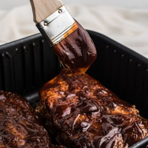 AIr Fryer BBQ Ribs with extra sauce being added.