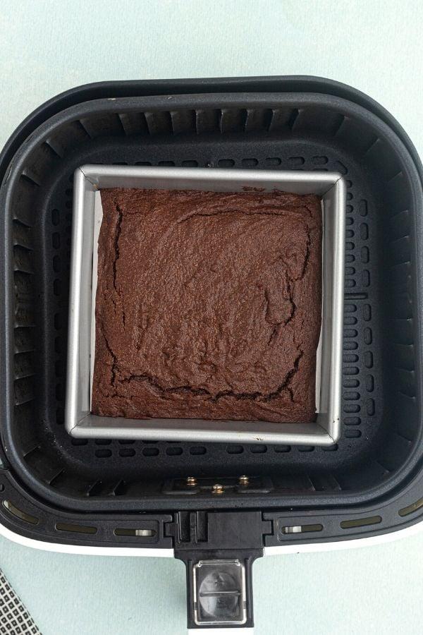 Air Fryer chocolate brownie cooked in the air fryer basket.