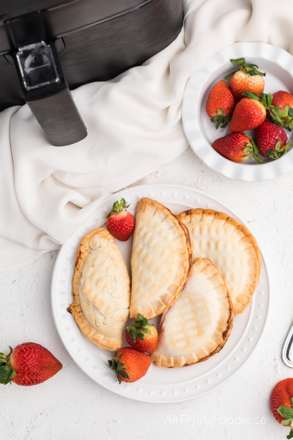 Strawberry Cream Cheese Hand Pies on a white plate made in the Air Fryer.