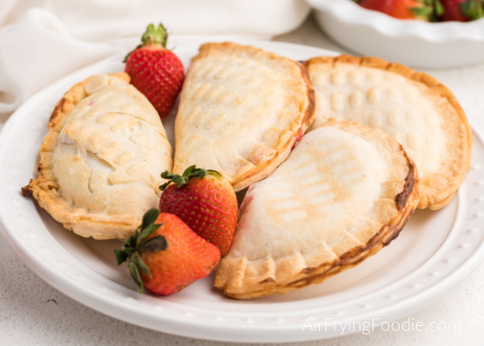 Plate of strawberry cream cheese pies made in the Air Fryer on a white plate.