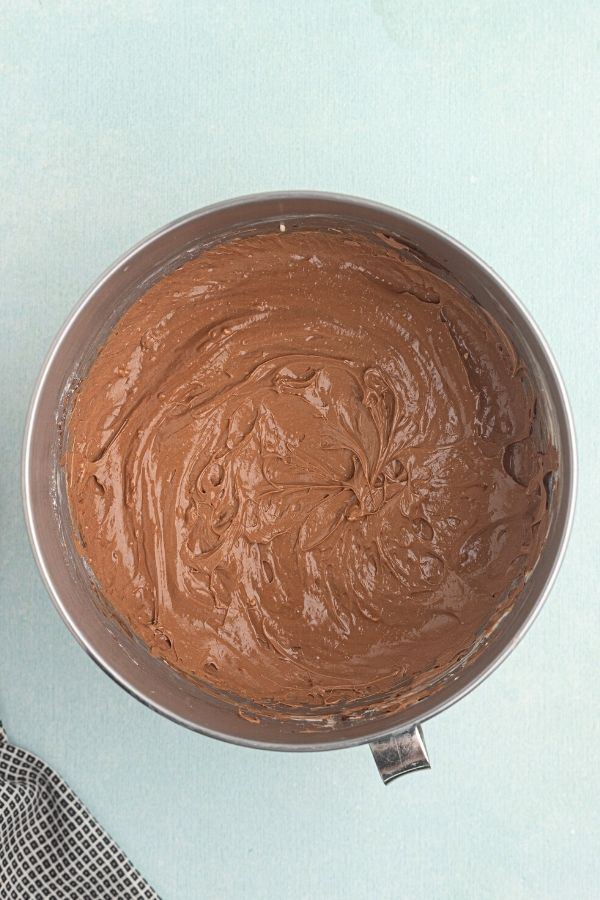 Chocolate cheesecake filling, mixed in a bowl.
