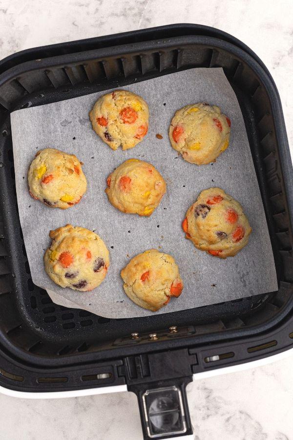 Cooked sugar cookies in the air fryer basket.