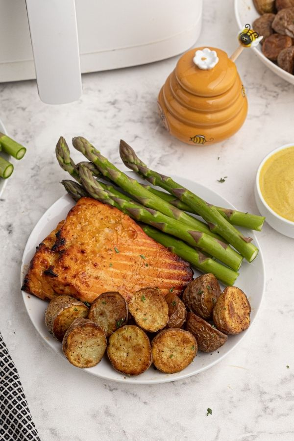 Roasted potatoes served with honey mustard salmon and asparagus