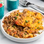 Keto friendly taco casserole made in the air fryer and served on a white plate.