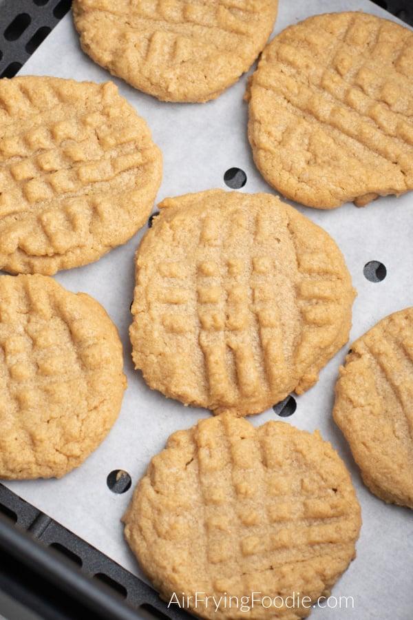 Peanut Butter cookies in an Air Fryer basket.