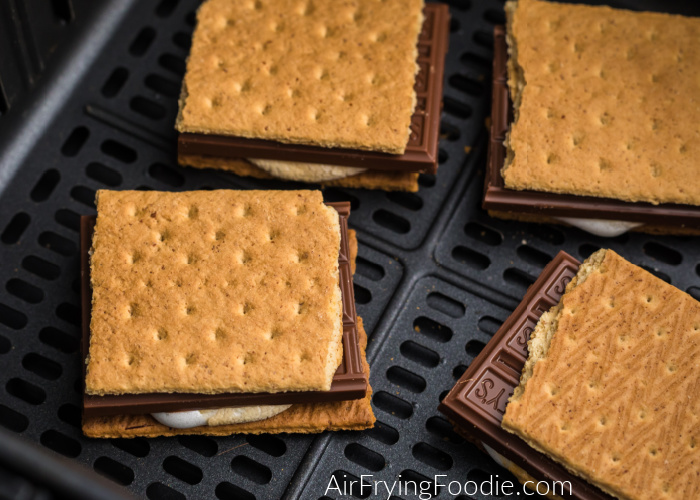 S'mores are lined in the bottom of the basket of the air fryer.