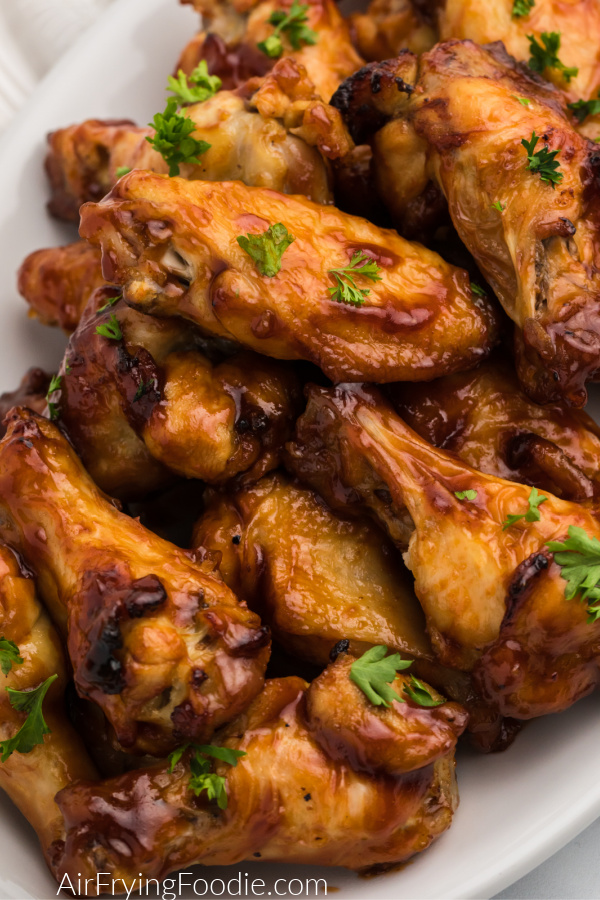 Close up photo of BBQ Chicken Wings that were made in the Air Fryer and served on a white serving plate.
