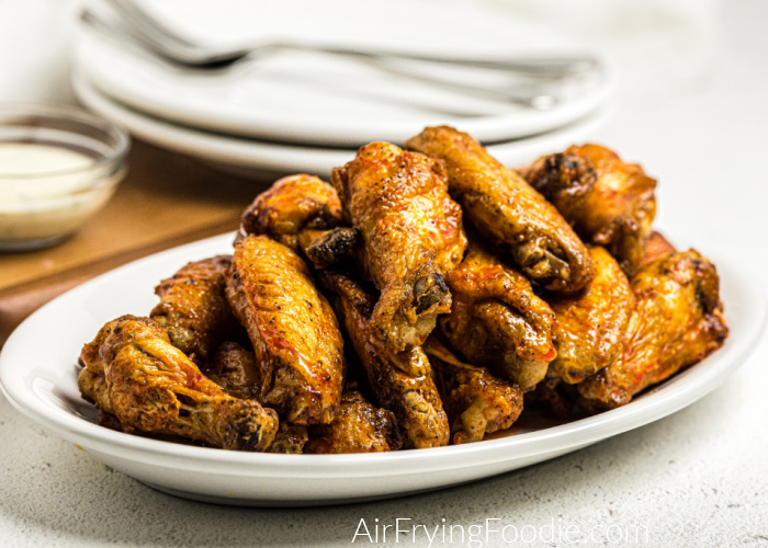 Buffalo Chicken Wings on a white plate ready to serve.