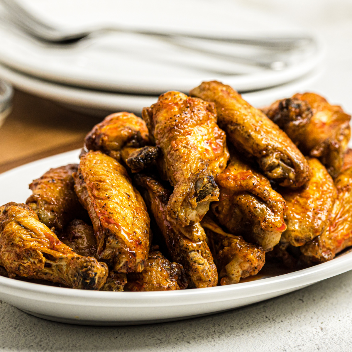 Air Fried Buffalo Chicken Wings on a white serving dish.