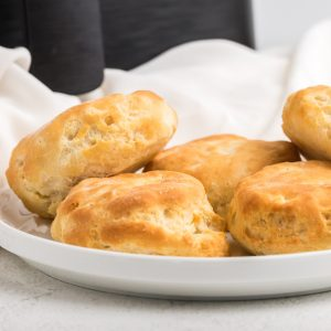 air fryer canned biscuits on a white plate.