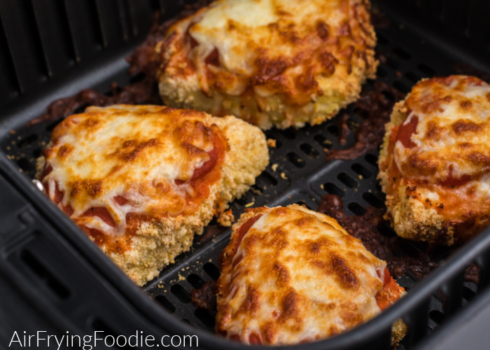 Chicken parmesan in the Air Fryer basket, ready to dish and serve.