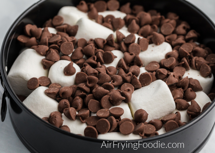 chocolate chips and marshmallows in a Springform pan before being placed into the Air Fryer.