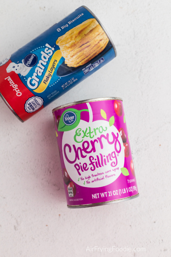 A can of Grands biscuits and a can of cherry pie filling to make cherry pie bombs in the Air Fryer.