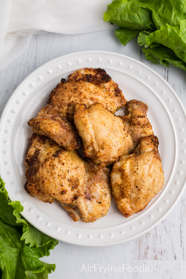 Air Fried Chicken Thighs on a white plate ready to serve.