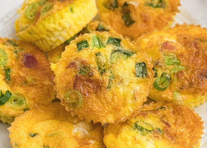 Close up shot of egg bites stacked on top of each other.