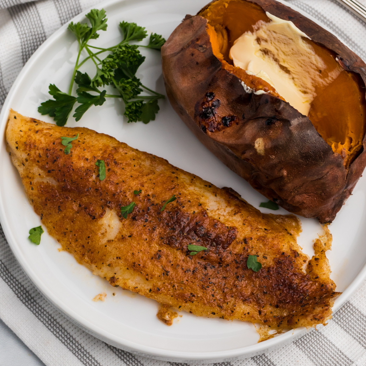 Blackened Air Fryer Swai Fish on a white plate.