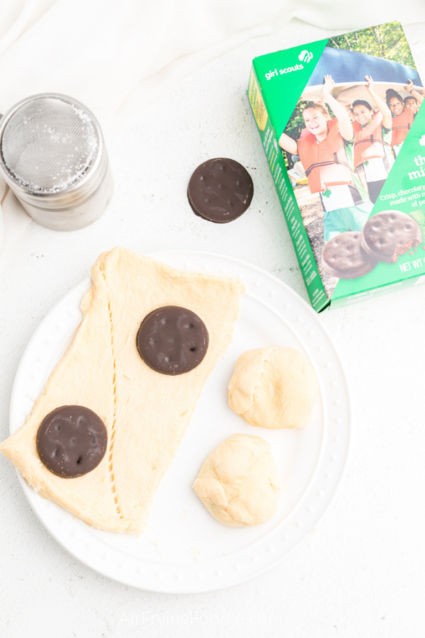 Ingredients needed for air fryer thin mints: think mints on crescent dough sheets, getting ready to be rolled and fried.