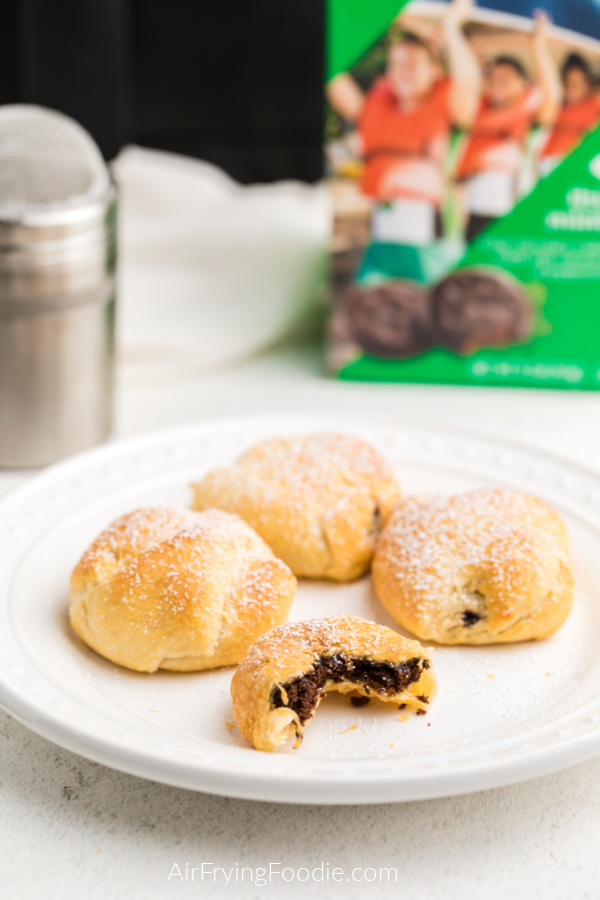 Air Fried Thin Mints on a white plate and topped with powdered sugar.