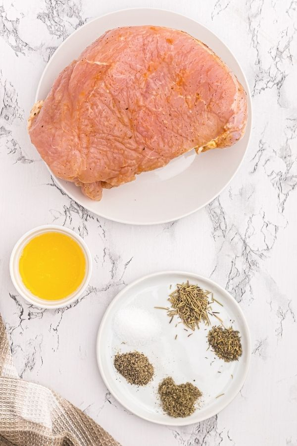 Ingredients needed to make turkey breast. Melted butter, and herbs.