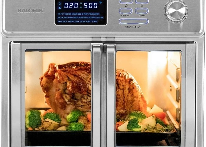 Kalorik brand oven shown with full chicken inside cooking.