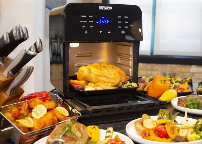 Showing a nuwave rack air fryer with meals prepared