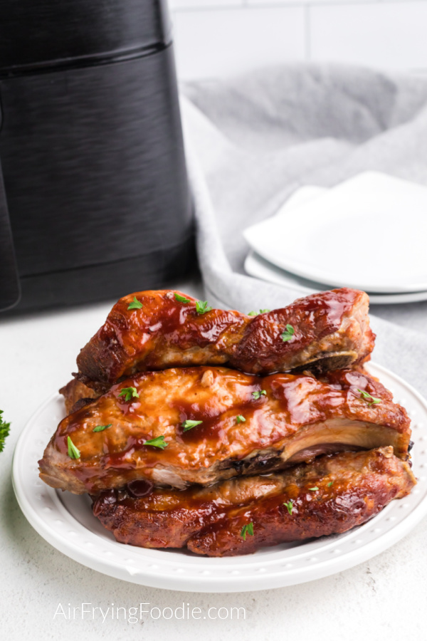 Country Style Ribs that were made in the air fryer, served on a white plate.