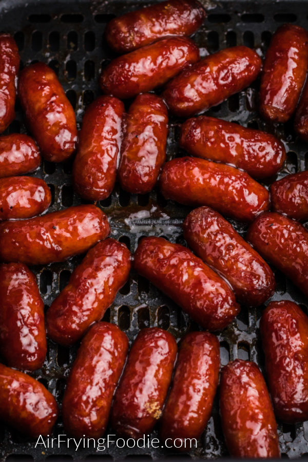 Cooked BBQ Litle Smokies in the basket of the air fryer.
