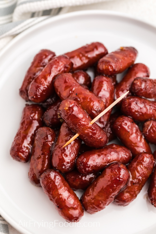 Air Fryer BBQ Little Smokies on a white plate ready to serve.
