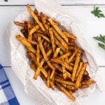 Golden crispy fries seasoned with salt pepper and more.
