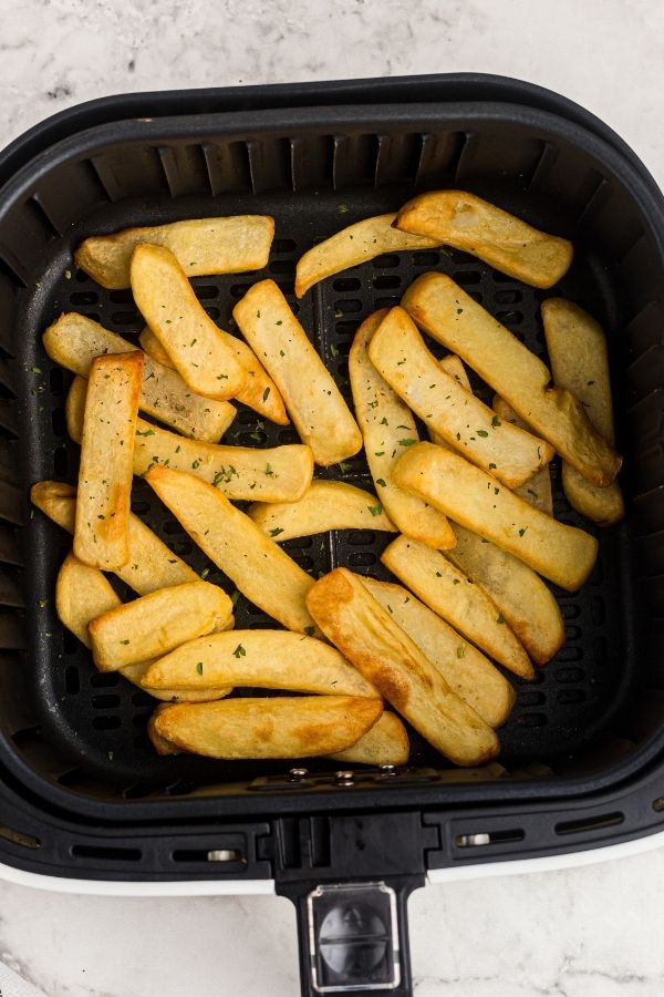 Golden steak fries after being cooked in the air fryer basket.