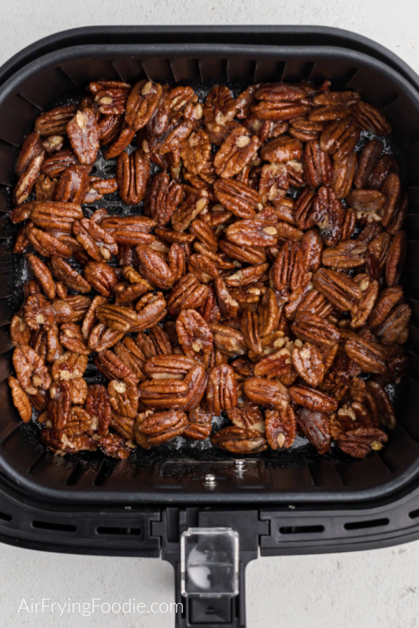 Sugared pecans in the air fryer basket.