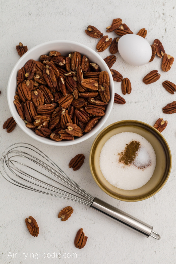 Ingredients needed to make sugared pecans in the air fryer.