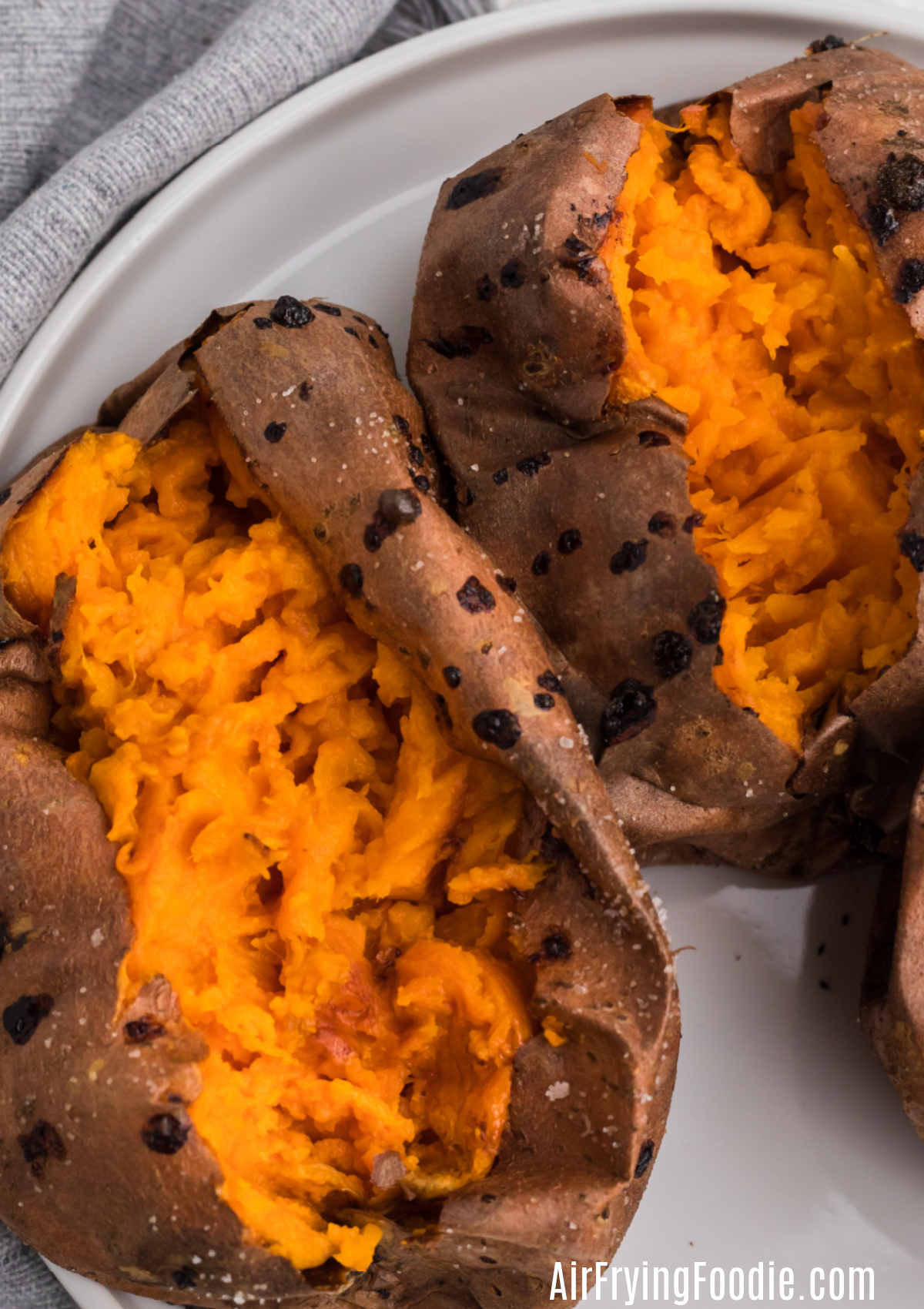Cooked and sliced baked sweet potatoes made in the air fryer.