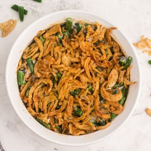 Golden green bean casserole after being cooked in the air fryer.