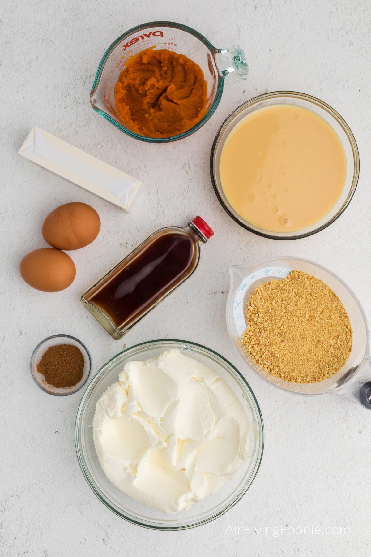 Ingredients needed to make pumpkin cheesecake in the air fryer.