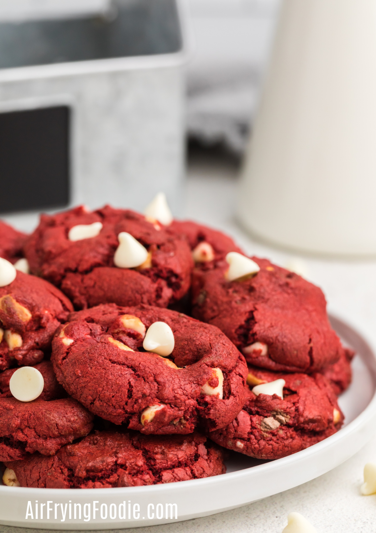 Air Fryer Red Velvet Cake Mix Cookies with white chocolate chips on a white plate ready to eat.