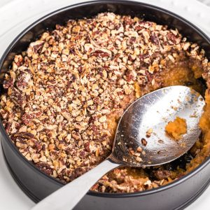 Air Fryer Sweet Potato Casserole with a scoop missing.
