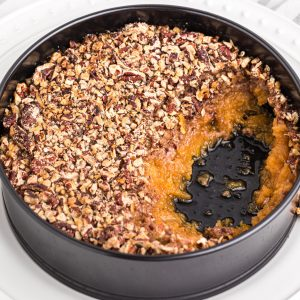 Sweet Potato Casserole made in the air fryer with a scoop missing.