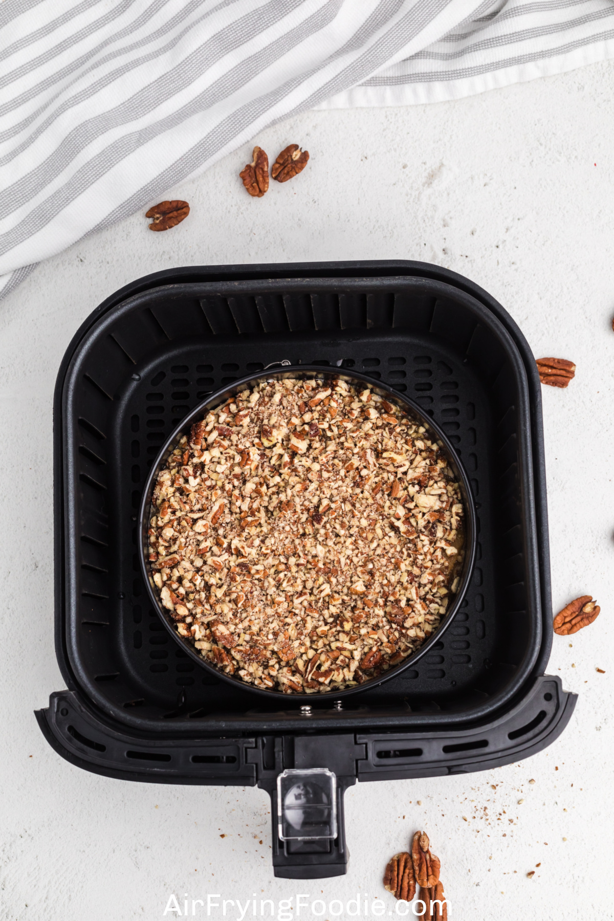sweet potato casserole in the basket of the air fryer, ready to cook.