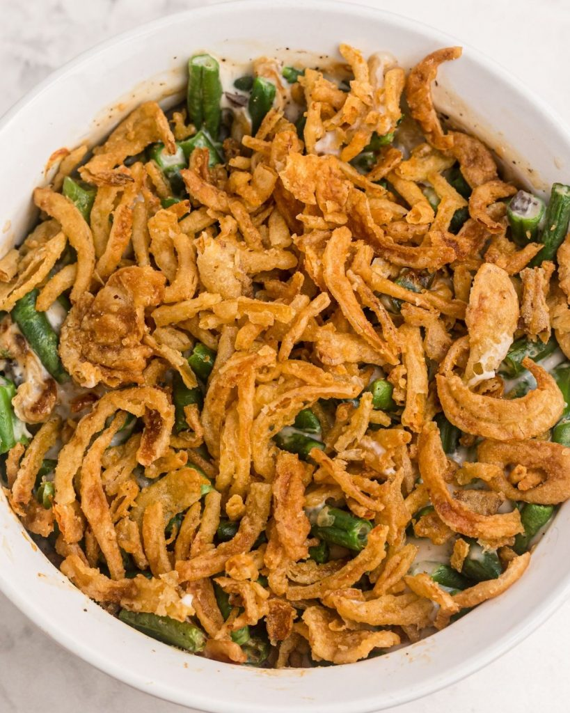 Close up photo of green bean casserole after being cooked in the air fryer.