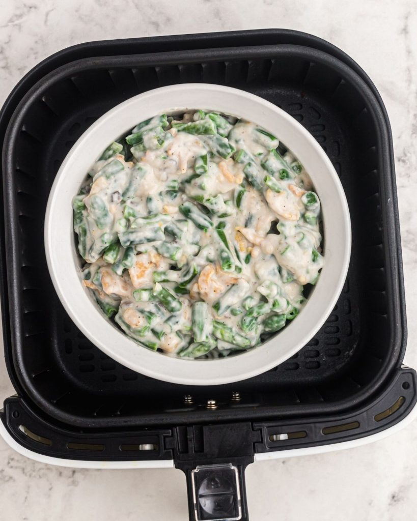 Casserole before being cooked in a pyrex dish in the air fryer basket.