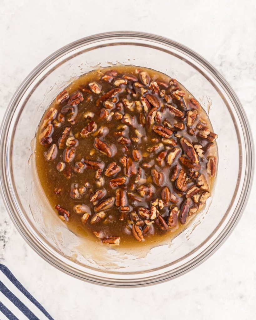 Pecan pie filling after being  mixed, in a glass bowl.