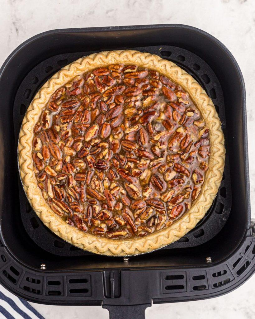 Pecan pie before being cooked in the air fryer basket.
