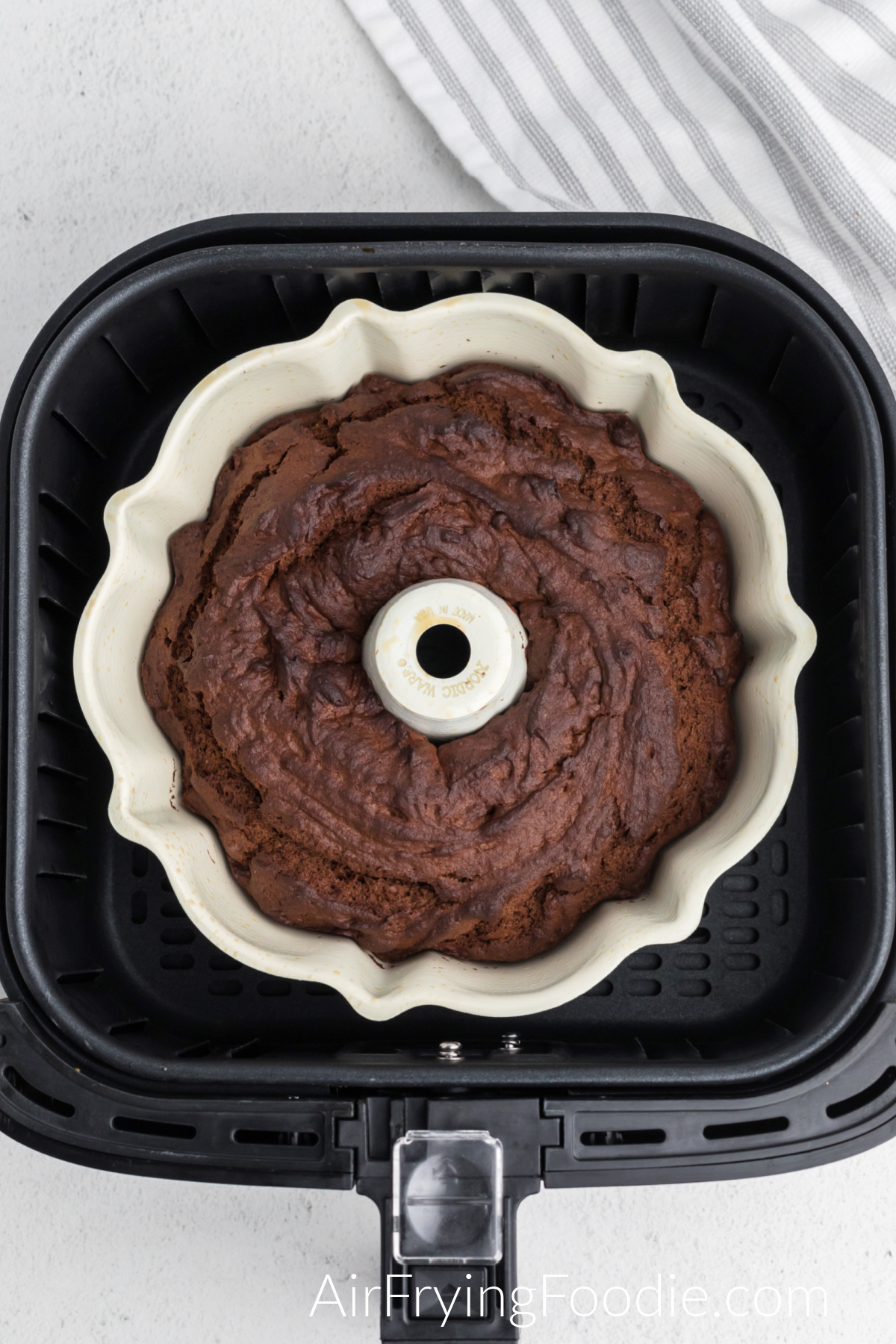 Cooked chocolate bundt cake in the air fryer basket.