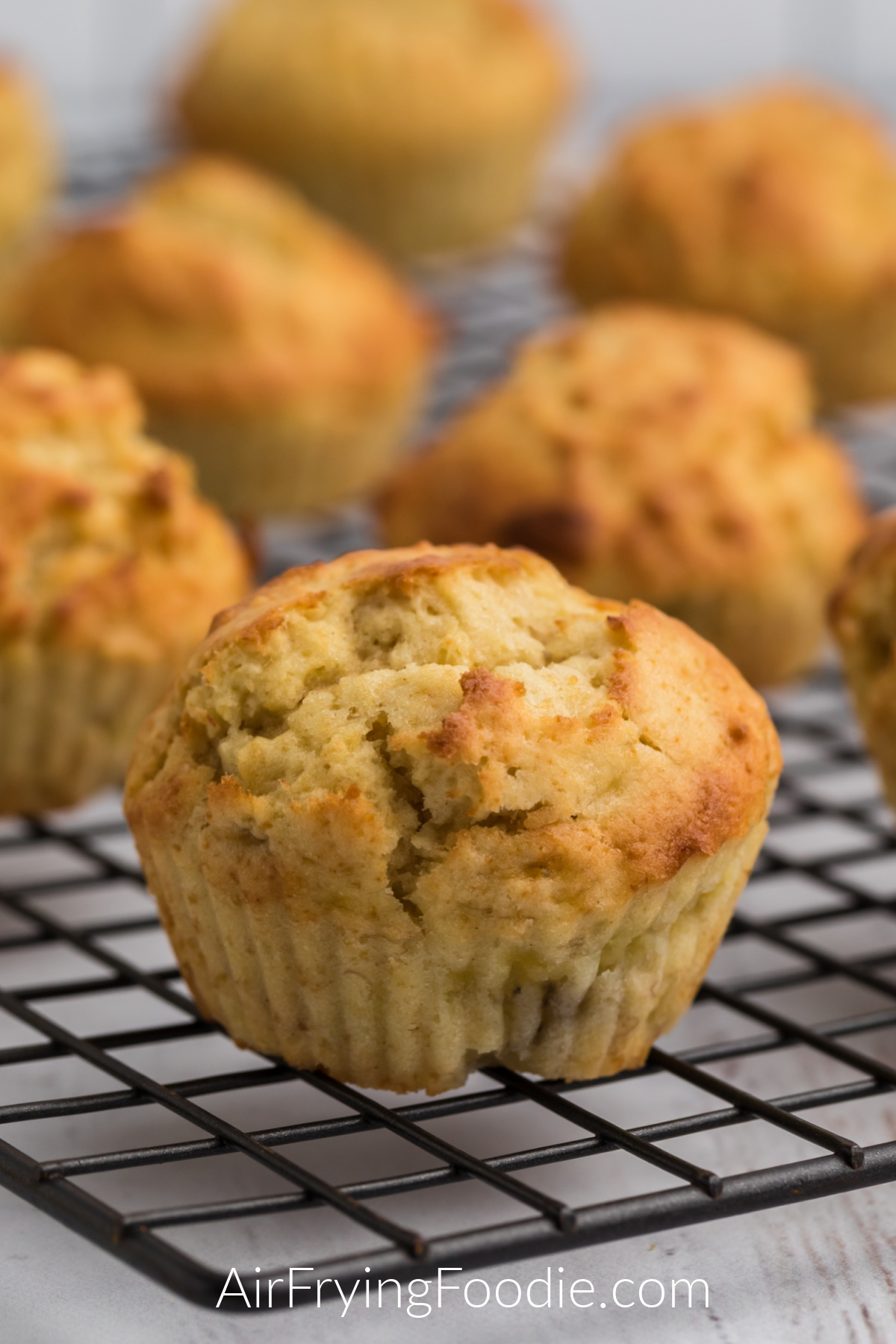 Close up photo of banana muffins on a cooling rack.