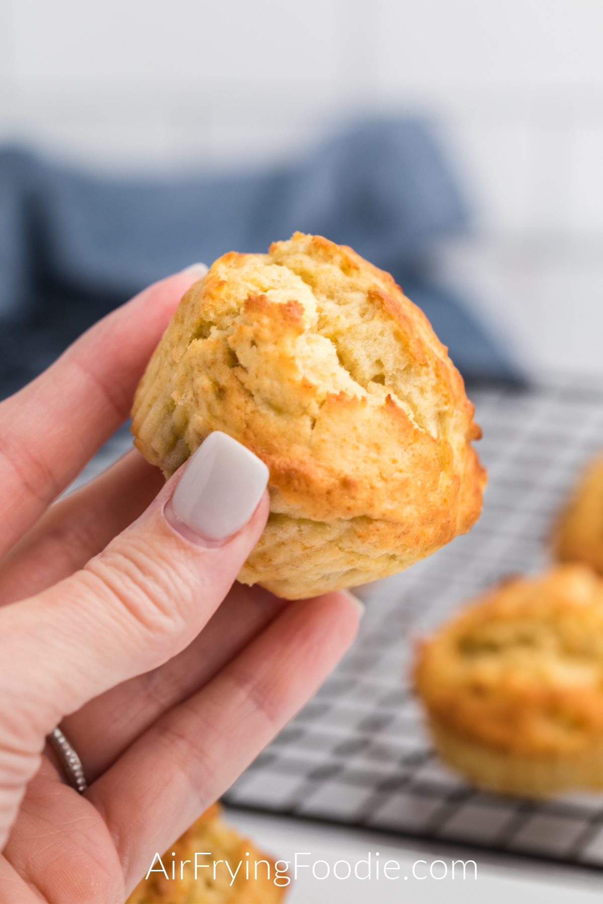 Air Fryer Banana Muffin in a hand ready to eat.
